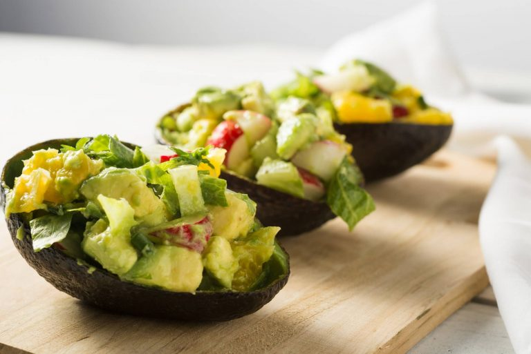 Zesty Guacamole with Mexican chicken on pita crisps